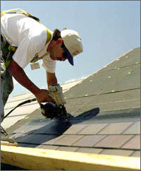 Photo of roof shingles that are coated with PV cells.
